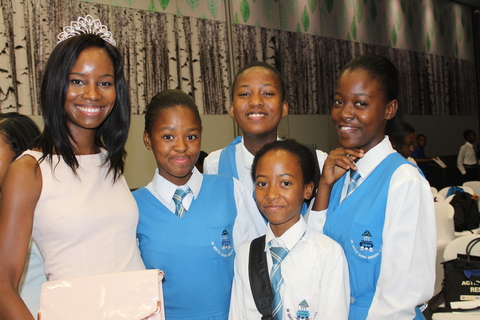 Some of the adolescent girls with 2016 Miss Botswana 1st Princess, Bonnie Kamona
